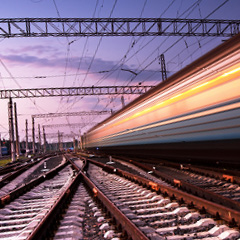 Image shows a fast passing train at night